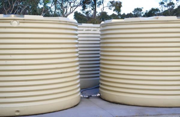3 Rainwater Tanks In The Backyard