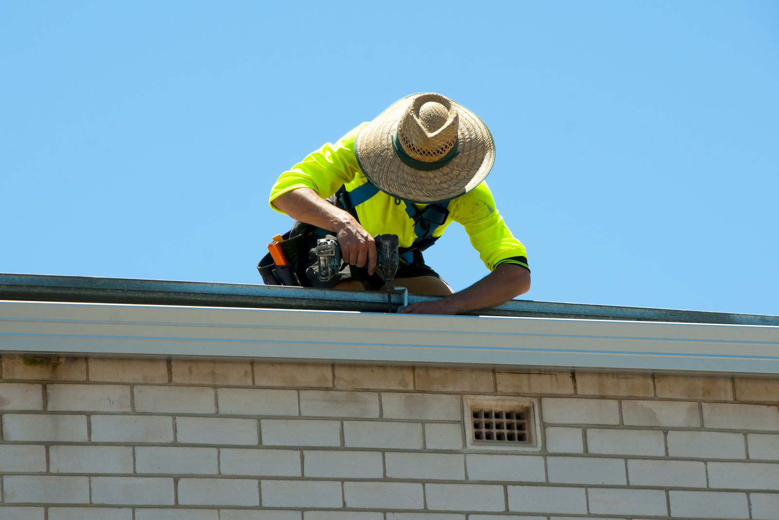 Builder Repairing Roof