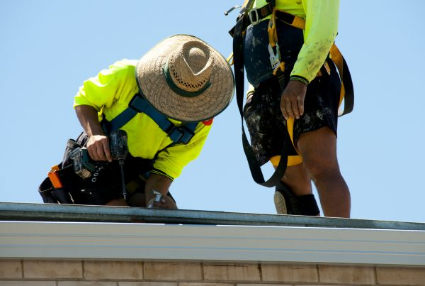 Two Workers Fixing A Roof